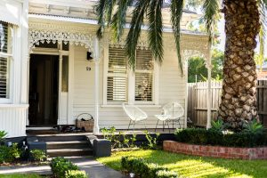 front porch with white chairs in baton rouge