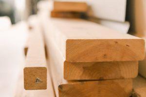 stack of lumber representing soaring lumber prices
